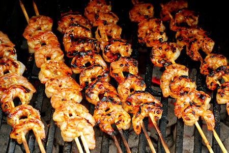 Remove the skewers from the grill, brush with the glaze, and sprinkle ...